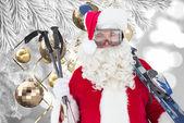 Happy santa posing with ski and ski poles — Foto de Stock