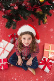 Festive little girl with gifts — Stock Photo