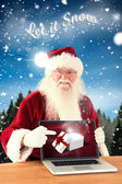 Happy Santa showing laptop screen — Стоковое фото