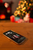 Santa elf and reindeer against smartphone — Stockfoto