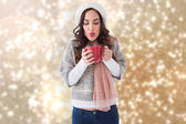 Brunette in winter clothes holding hot drink — Stock Photo