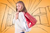 Blonde keeping a secret holding bags — Stock Photo