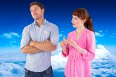 Woman arguing with uncaring man — Stock Photo