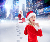 Festive blonde blowing a kiss — Stock Photo