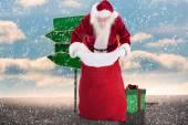 Santa looks in his bag — Photo