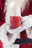 Santa holds red cup — Photo