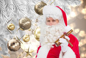Santa claus holding beer and cigar — Foto de Stock