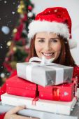 Festive redhead holding christmas gifts — Stok fotoğraf
