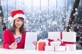 Festive brunette shopping online with tablet — Foto Stock