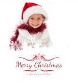 Cute little girl wearing santa hat — Stock Photo