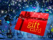 Santa flying behind gift card — Stock Photo