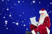 Santa sits and uses laptop — Foto de Stock