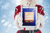 Composite image of santa presents a tablet pc — Stock Photo