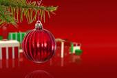 Composite image of red christmas decoration hanging from branch — Stock Photo