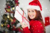 Redhead holding christmas gift — Stock fotografie