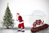 Santa pulling snow globe of presents — Foto Stock