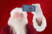Santa taking selfie on phone — Stock Photo