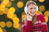 Woman wearing warm ear muffs — Foto Stock