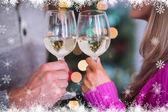 Composite image of happy couple enjoying some wine — Stock Photo