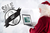 Santa Claus uses a laptop — Stock Photo