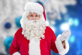 Portrait of perplexed santa holding — Stock Photo