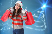 Composite image of cheerful brunette holding shopping bags full  — Zdjęcie stockowe