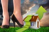Businesswomans legs against green grass — Stock Photo