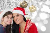 Composite image of mother and daughter in santa hats — Foto de Stock