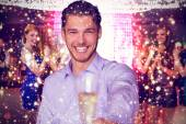 Composite image of man offering champagne — Stock Photo