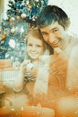 Father and little girl playing with christmas — Stock Photo