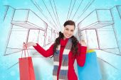 Brunette in winter clothes holding shopping bags — Stock Photo