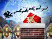 Santa flying behind chimney — Stock Photo