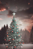Christmas tree with falling snow — Stock Photo