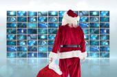 Santa llevar saco de regalos — Foto de Stock