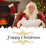 Happy santa writing list with a quill — Stock Photo