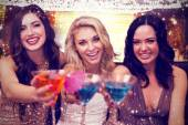 Composite image of pretty friends drinking cocktails together — Stock Photo