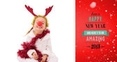 Little girl wearing red nose and tinsel — Foto Stock