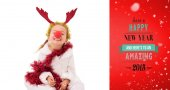 Little girl wearing red nose and tinsel — ストック写真