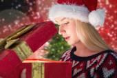 Festive blonde opening gift — Стоковое фото