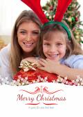 Mother and daughter holding Christmas presents — Stock Photo
