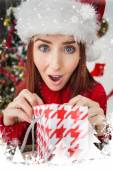 Festive redhead opening christmas gift — Stockfoto