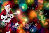 Santa Claus has fun with guitar — Stock Photo