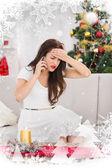 Brunette o phone on christmas day — Stock Photo