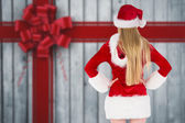 Festive blonde standing rear view — Stock Photo