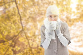 Woman in warm clothing holding mugs — Photo