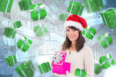 Brunette opening christmas gift while looking — Stock Photo