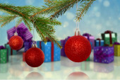 Composite image of baubles on tree — Foto Stock