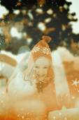 Festive little girl in hat and scarf — Stockfoto