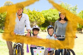 Composite image of family with their bikes — Stock Photo