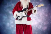Santa Claus plays guitar with sunglasses — Stock Photo
